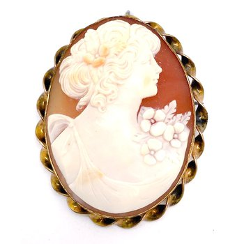 Lady's vintage, gold plated, cameo brooch