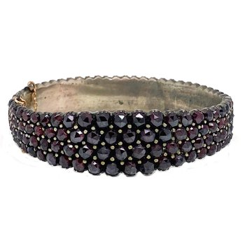 Lady's vintage garnet and silver tone bangle