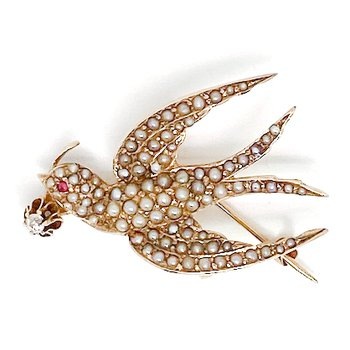 Lady's Art Nouveau style seed pearl, diamond, and ruby bird brooch