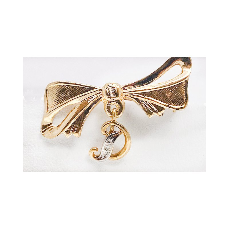 """Estate & Vintage Lady's vintage  diamond and two-tone gold bow brooch with a """"D"""""""