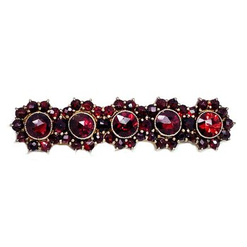 Lady's vintage style garnet and gold and silver tone bar brooch