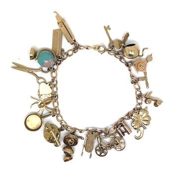 Lady's vintage; yellow gold charm bracelet