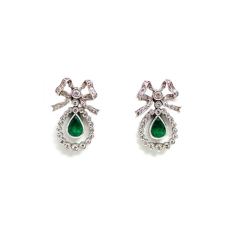 Estate & Vintage Lady's Victorian style emerald, diamond and white gold earrings, designed in the shape of a bow