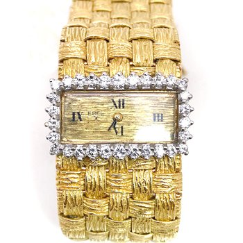 Vintage diamond, white and yellow gold, Ebel watch, with a wide mesh band