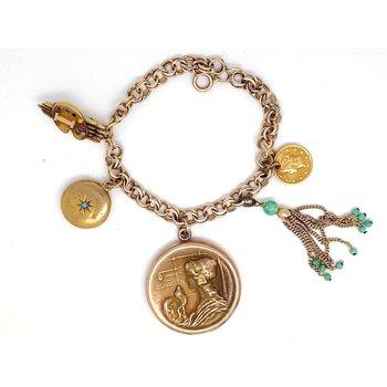 Lady's vintage yellow gold charm bracelet