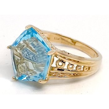 Lady's vintage blue topaz and two-tone gold ring