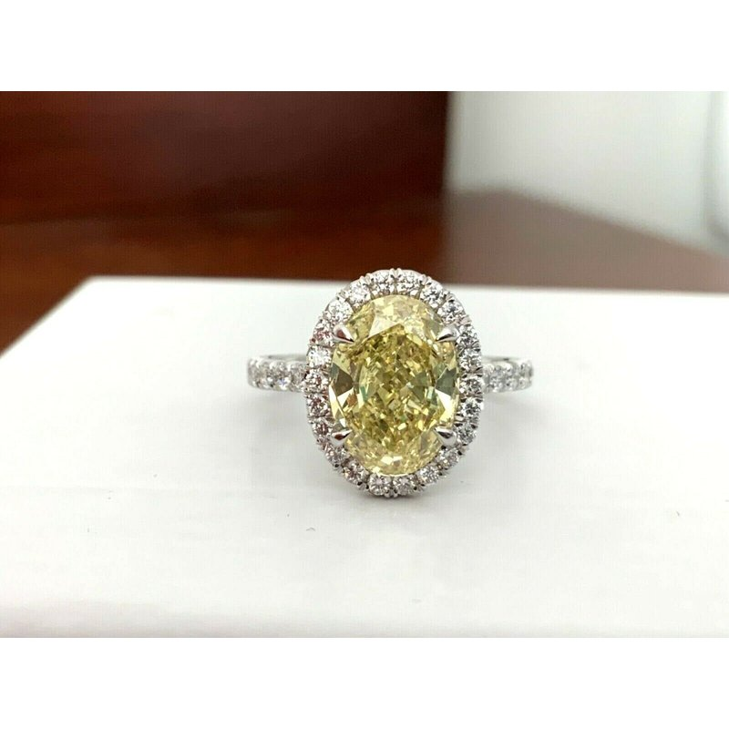 GIA Certified 3.21 ct Fancy Yellow OVAL Diamond Ring