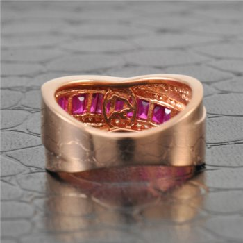 Ruby and Diamond Crossover Style Ring in Rose Gold