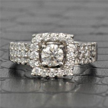 0.50 Carat Round Brilliant Cut Diamond Halo Engagement Ring in White Gold