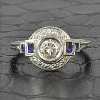 Vintage Inspired 0.53 Carat Round Brilliant Cut Diamond Engagement Ring With Sapphire Accents