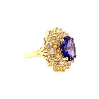 Elegant Tanzanite and Diamond Ring in Yellow Gold