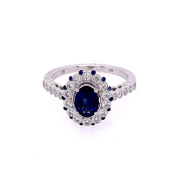 Oval Cut Blue Sapphire and Diamond Ring in 18k White Gold