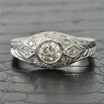 0.23 Carat Round Brilliant Cut Bezel Set Diamond Engagement Ring