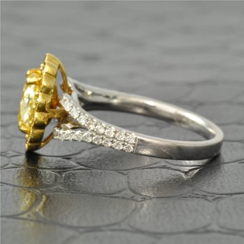 0.81 Carat Fancy Yellow Oval Cut Diamond Halo Engagement Ring