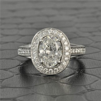 2.0 Carat Oval Cut Diamond Halo Engagement Ring in 18K White Gold