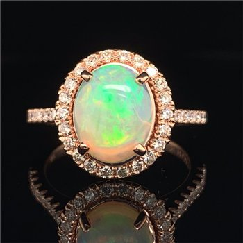 Opal and Diamond Halo Ring in Rose Gold