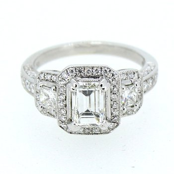 Emerald Cut Three Stone Halo Diamond Ring