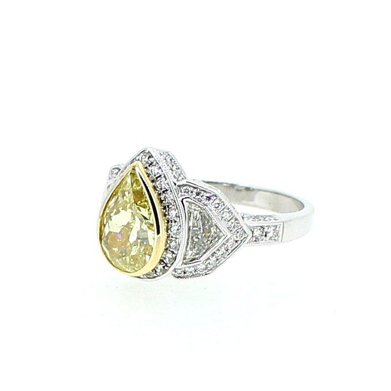 Decor Fancy Yellow Pear Diamond Halo Ring