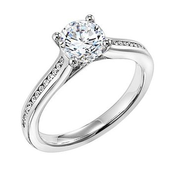 Delicate, channel set diamond band accentuating round diamond center stone