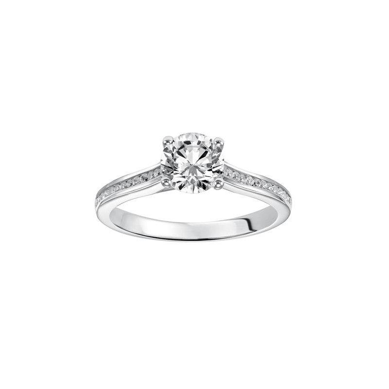 Delicate, channel set diamond band accentuating round diamond center stone
