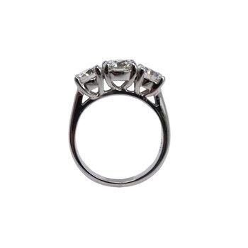 A three diamond ring featuring three round brilliant cut diamonds