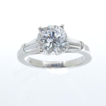 PLATINUM SOLITAIRE RING WITH BAGUETTES