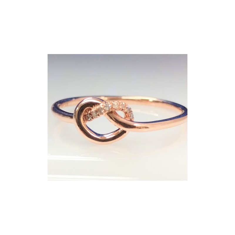 Showcase Collection 10KR Love Knot Ring with Diamond Accents