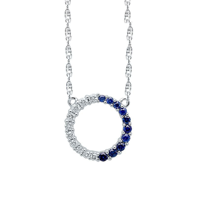 Greenberg's 10k white gold diamond and sapphire circle pendant