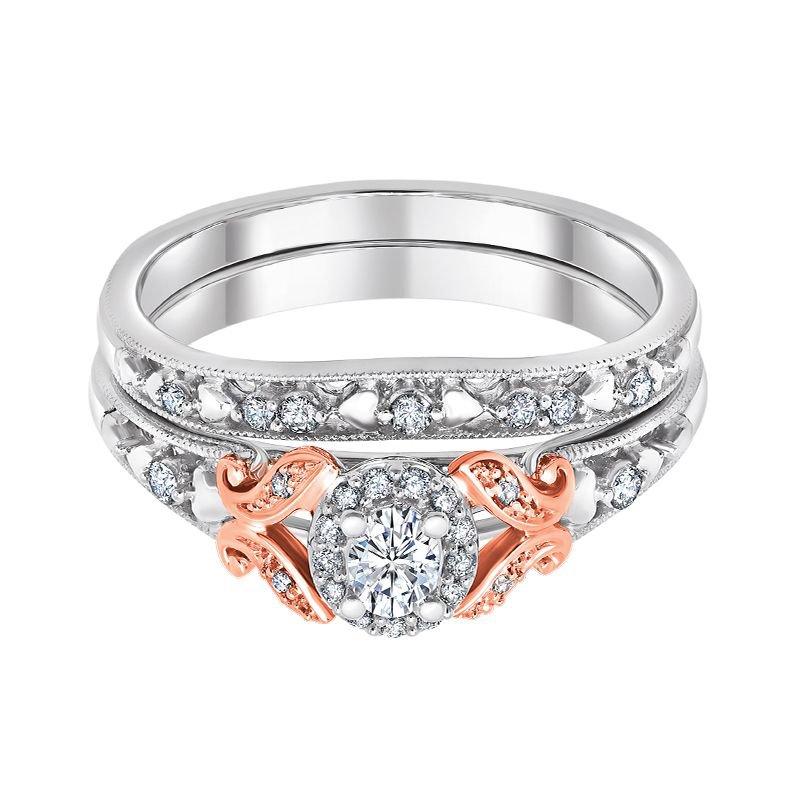 Greenberg's 10k white and rose gold 1/3ctw oval diamond bridal set