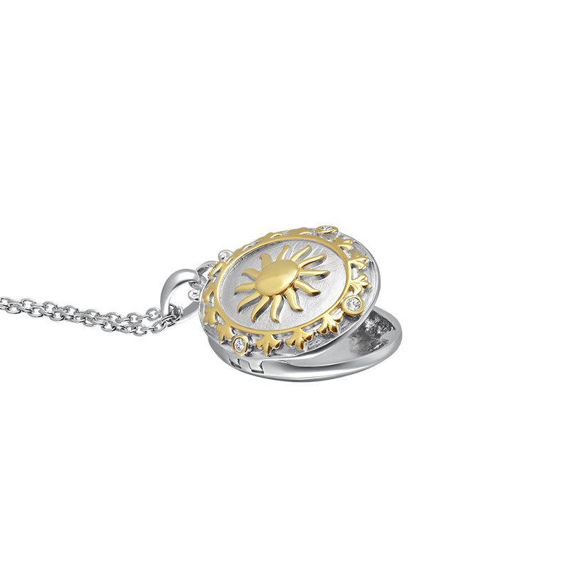 Greenberg's love star sterling silver with yellow micron plated sun locket