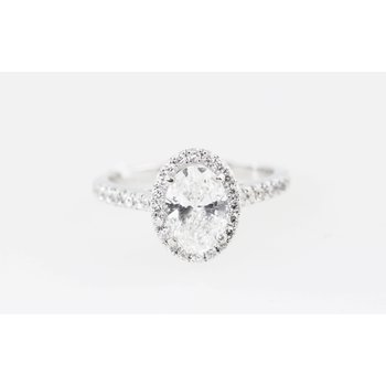 Oval diamond with halo engagement ring