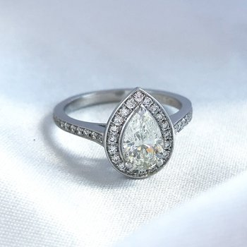 0.75CT Pear Shaped Side-Stone Halo Engagement Ring