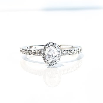 Oval Shaped Side-Stone Halo Engagement Ring