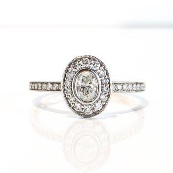 0.18CT Bezel Set Oval Shaped Halo Engagement Ring