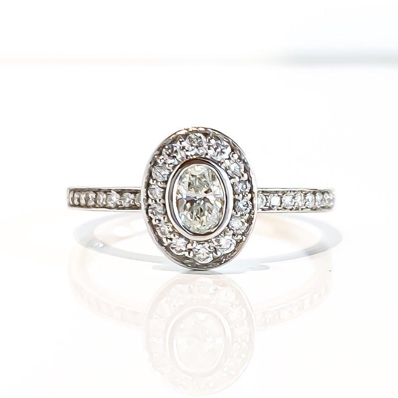 Corona 0.18CT Bezel Set Oval Shaped Halo Engagement Ring