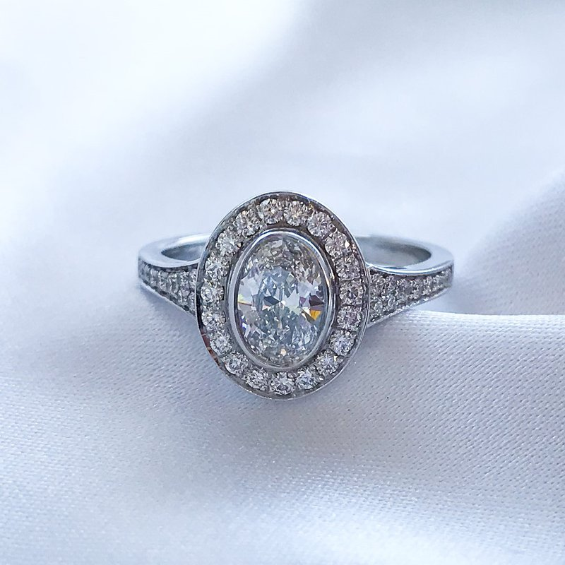 HJ Collection 0.60CT Bezel Set Oval Shaped Halo Engagement Ring