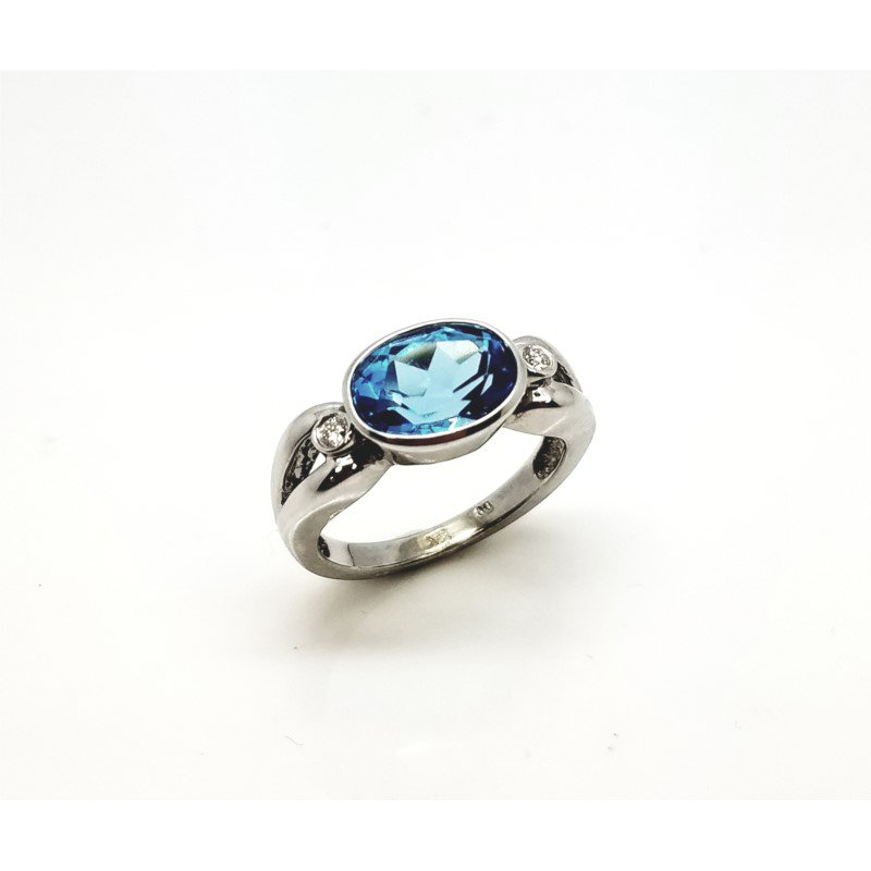 White Gold Blue Topaz Ring With Diamonds