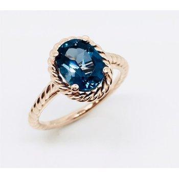 Rose Gold Blue Topaz Ring
