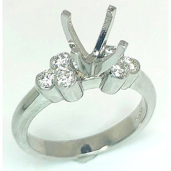 Platinum Ring with Bezel set Round Diamonds