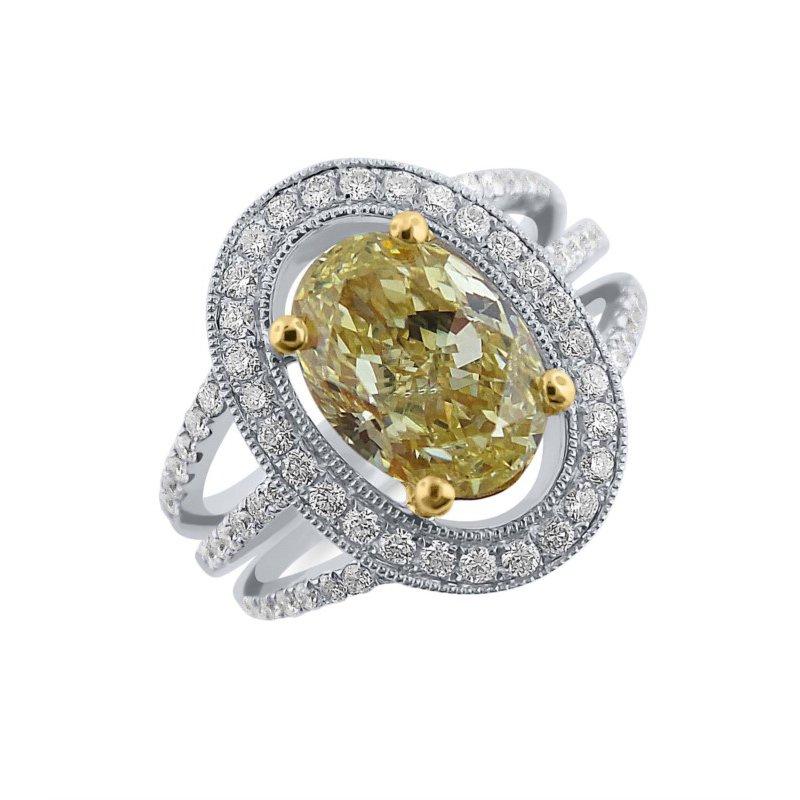 Breathtaking Natural 2 carat Yellow Diamond in Halo Ring