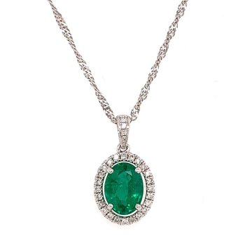 18 Karat Pendant With oval emerald surrounded by Diamonds