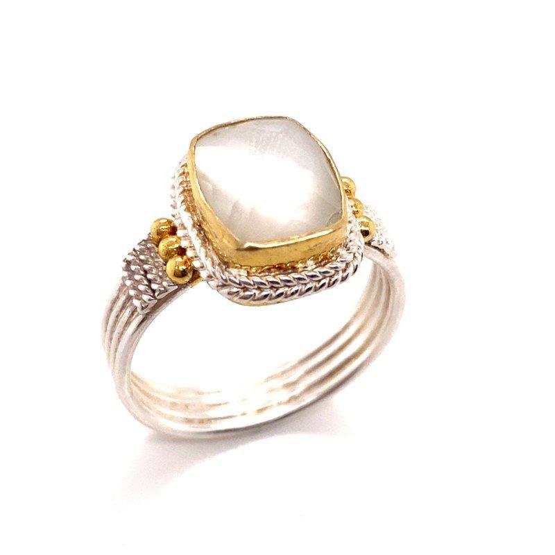 Gleaming Mother of Pearl Quartz Ring Set Amongst Fine Filigree Detail