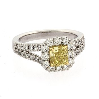 Fancy yellow diamond halo ring
