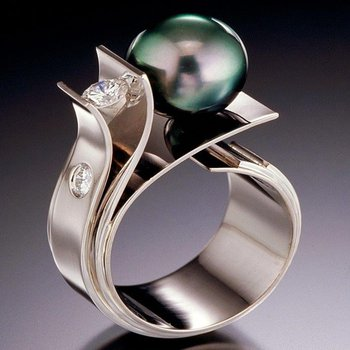 Uniquely set Tahitian pearl ring