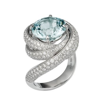 Swirl designed fashion ring with blue topaz