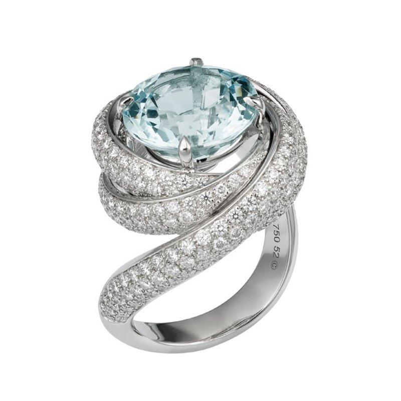 Antony Jewelers Swirl designed fashion ring with blue topaz
