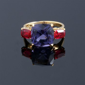 Fashion ring with rubies and blue sapphire