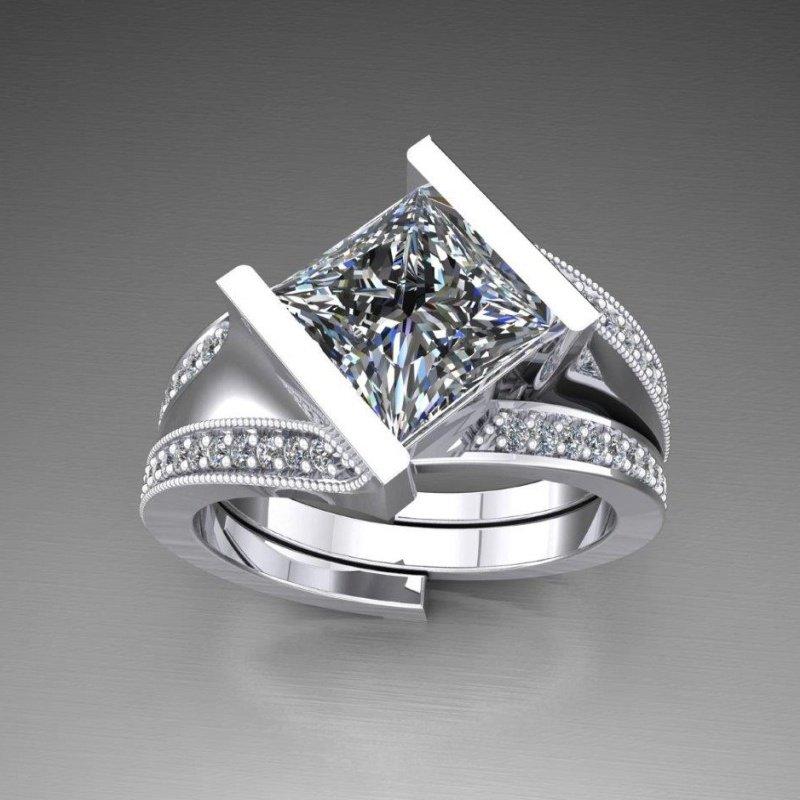 Antony Jewelers Swirl diamond engagement ring with matching band