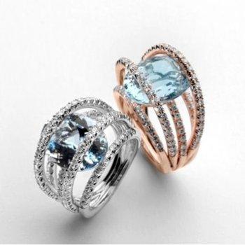 Multi-layered fashion ring with aquamarine