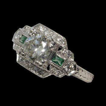 Antique engagement ring with diamonds and emeralds
